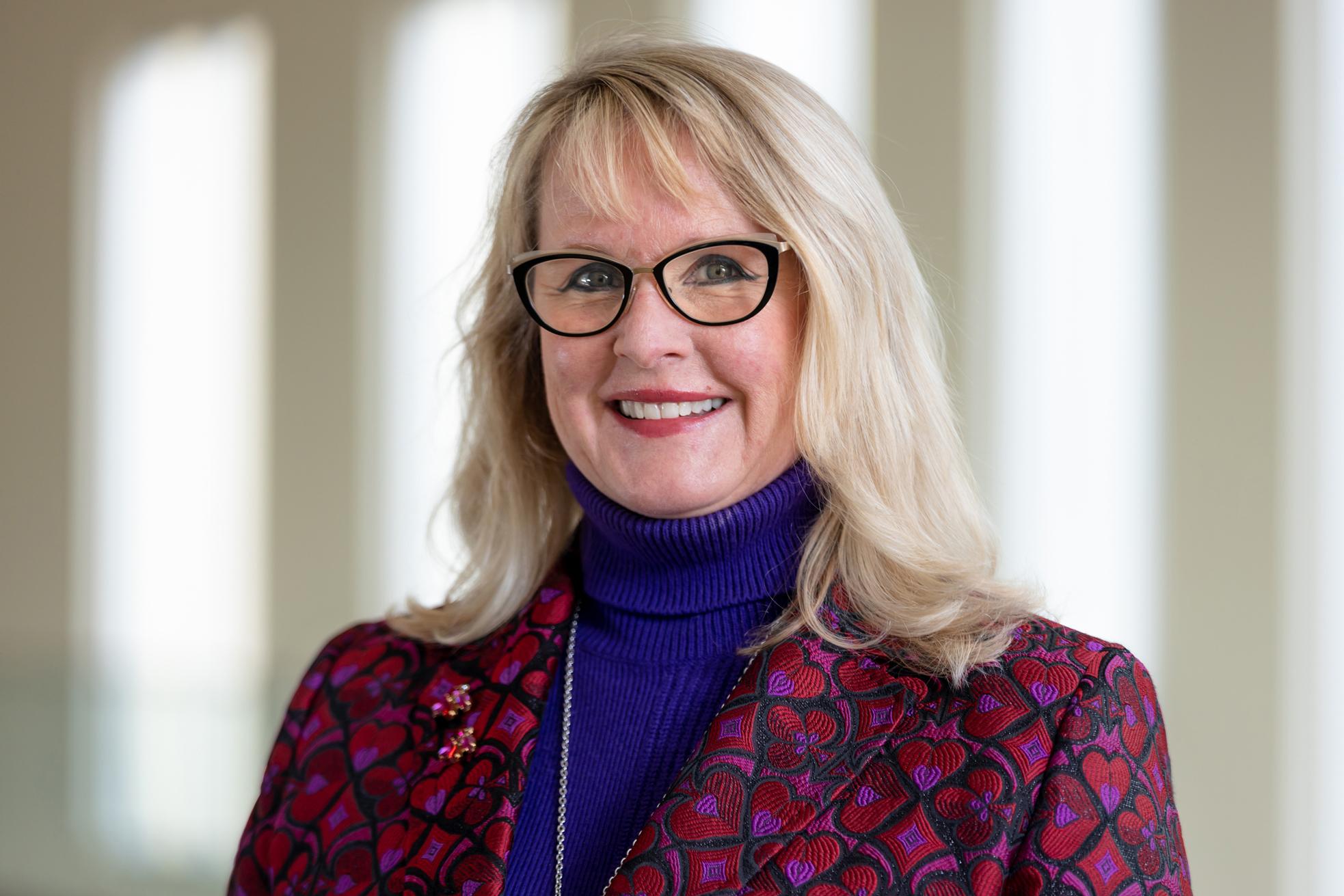 Headshot of Lou Kennedy, Speaker at the Women for Women Summit